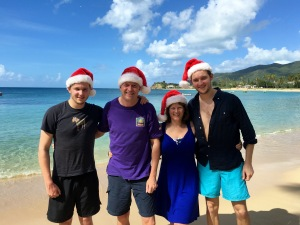 Foster family in festive spirit on the beach in Antigua