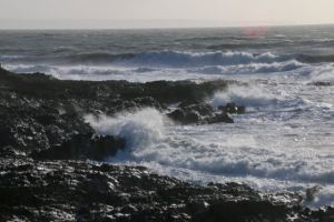 The waves crash against the rocks at Croyde - a reminder of the perils of the sea