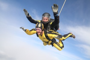 Alex enjoying his skydive in the clouds above Devon