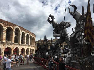Opera stage sets loom outside the Roman amphitheatre in Verona